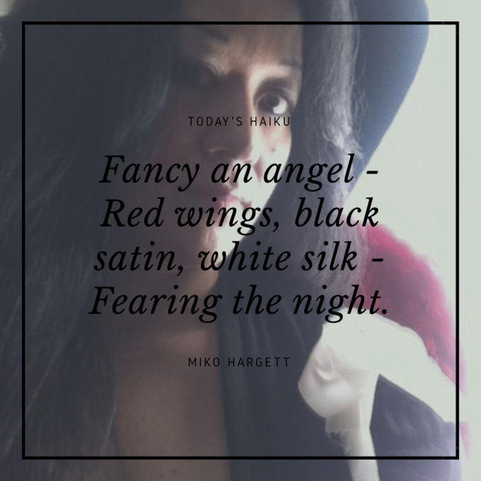 Selfie of Asian American woman Miko with red angel wings - fancy an angel